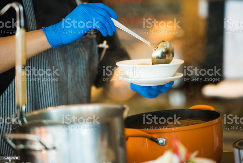 Chef cooking soup