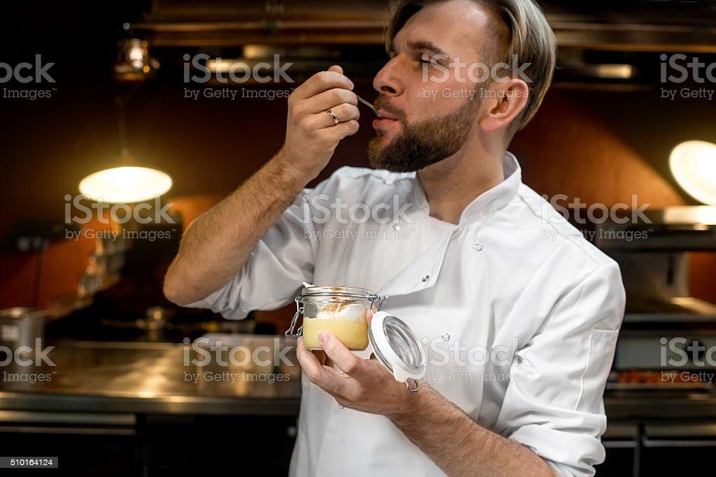 Chef cook tasting lemon dessert stock photo