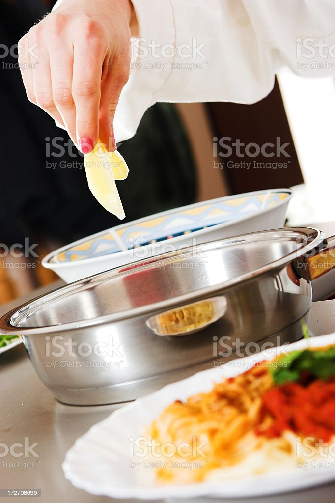 Chef cooking a meal royalty-free stock photo