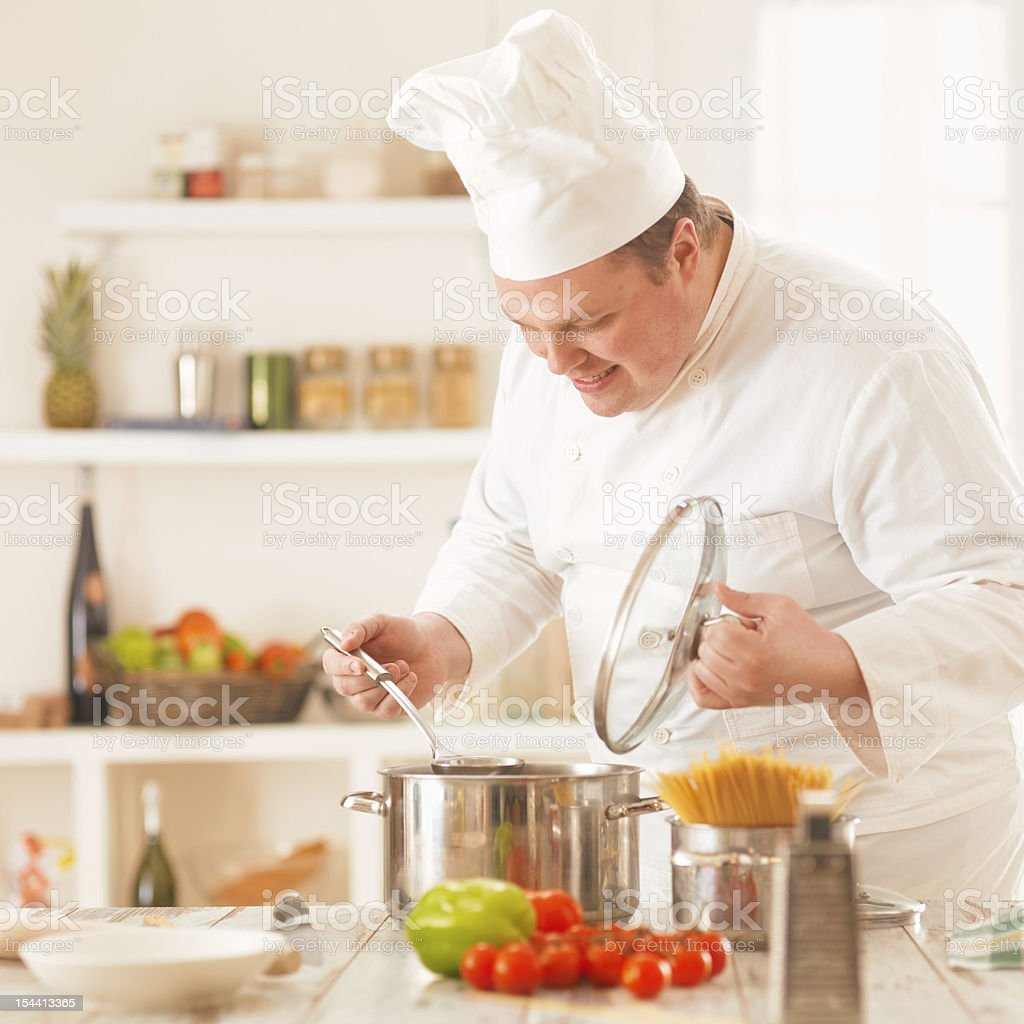 chef cooking a vegetable soup royalty-free stock photo
