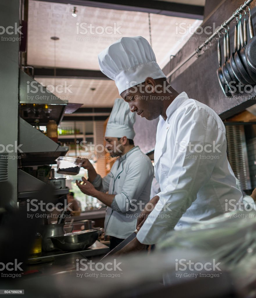 Chef cooking at a restaurant stock photo
