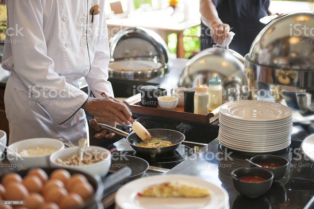Chef cooking eggs stock photo