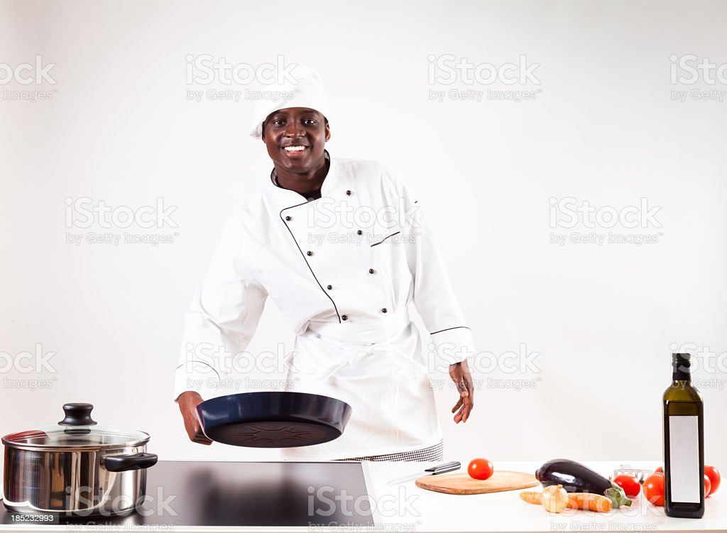 chef cooking in his kitchen stock photo