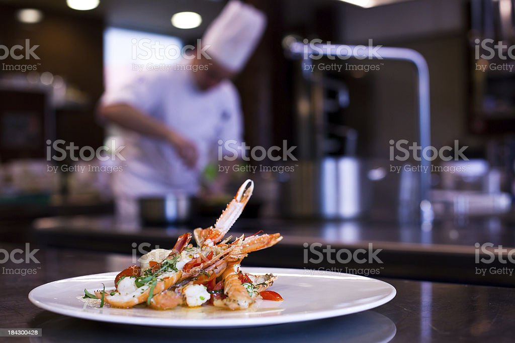 Chef Cooking in Restaurant Kitchen royalty-free stock photo