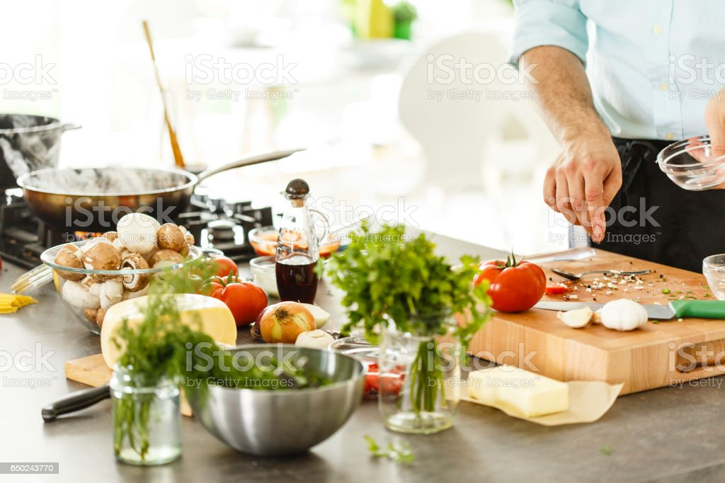Chef cooking in the kitchen stock photo