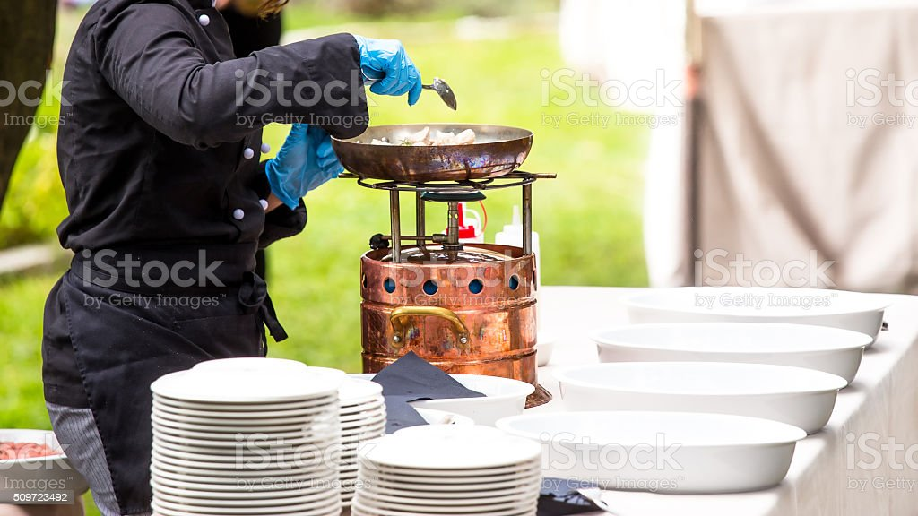 chef cooking meat on grill stock photo
