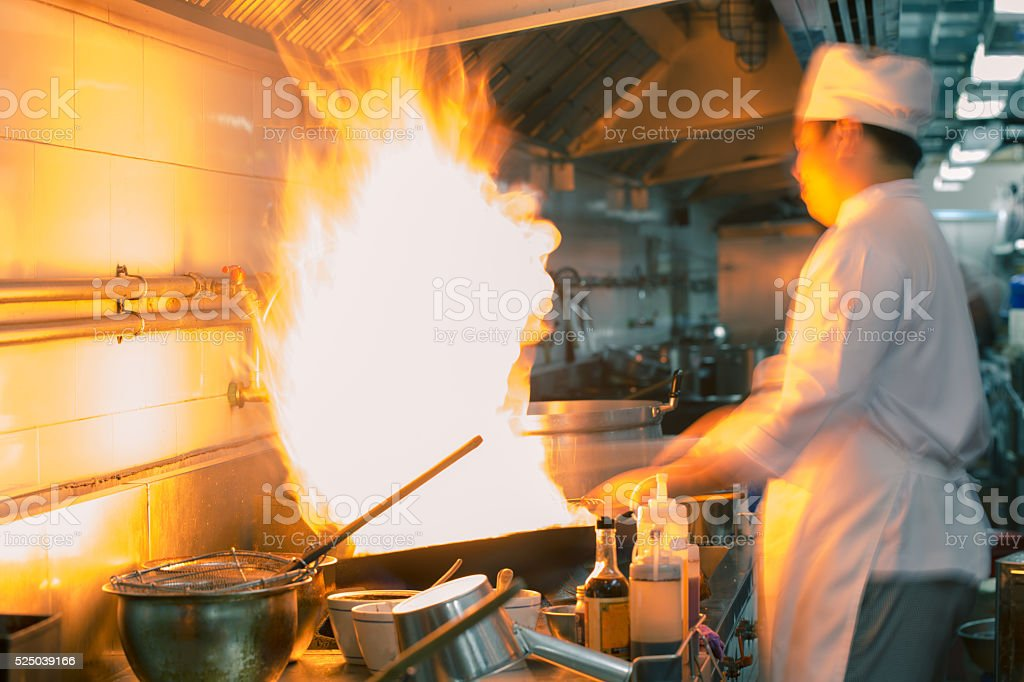 Chef cooking motion blur stock photo