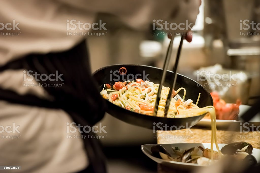 Chef cooking pasta stock photo