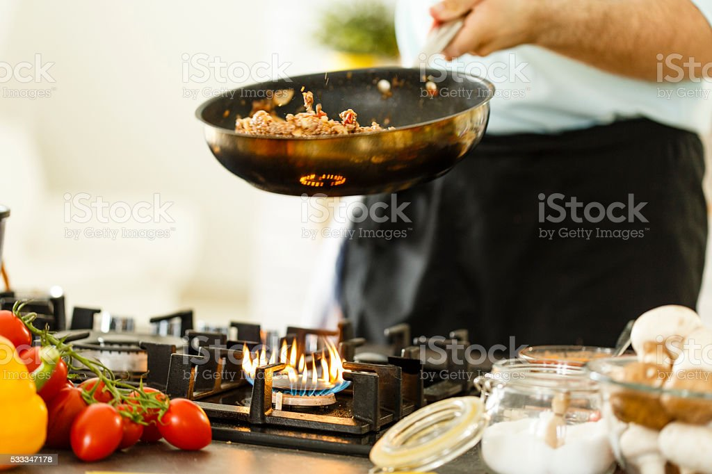 Chef cooking spaghetti bolognese stock photo