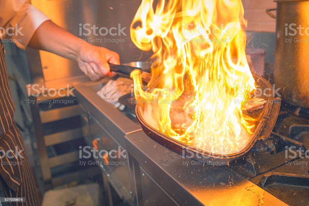 Chef cooking with flame stock photo