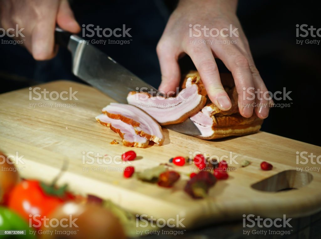 Chef cuts the meat knife stock photo