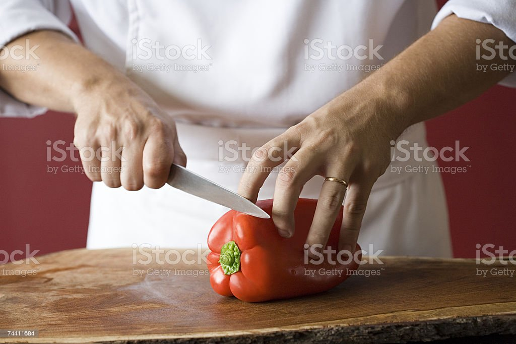 Chef cutting pepper royalty-free stock photo