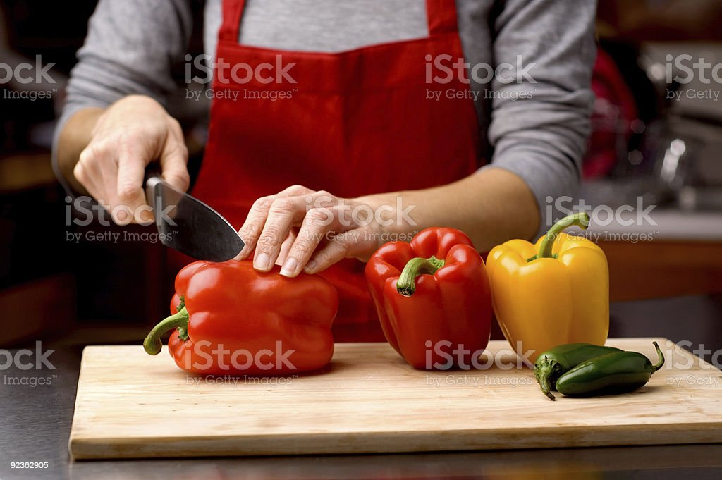 chef cutting peppers royalty-free stock photo