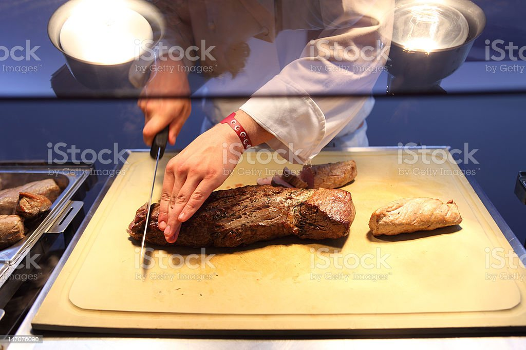 chef cutting prime rib steak royalty-free stock photo