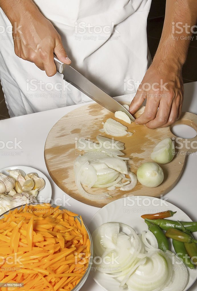 Chef cutting the onions royalty-free stock photo