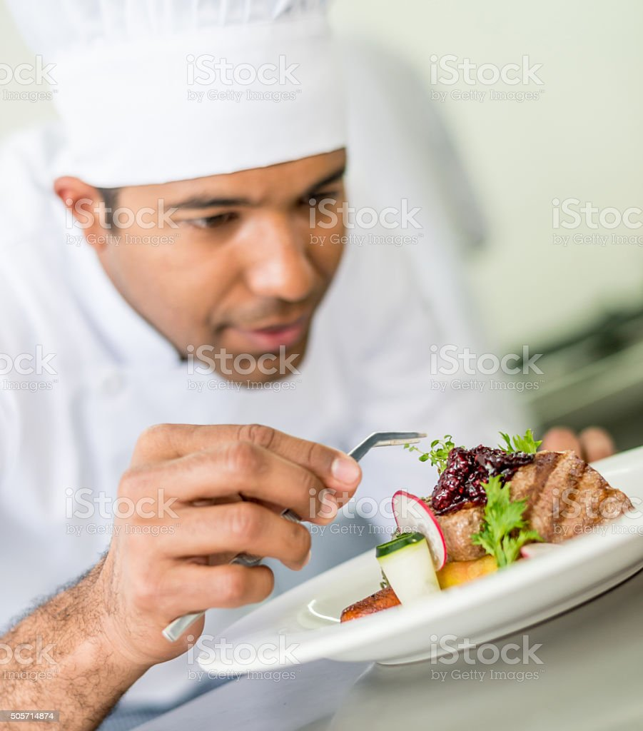 Chef decorating a plate stock photo
