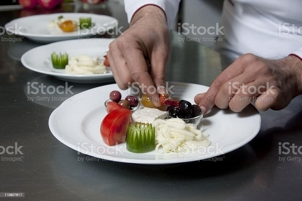 Chef decorating an appetizer dish royalty-free stock photo