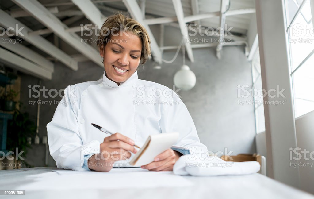 Chef doing the books at a restaurant stock photo