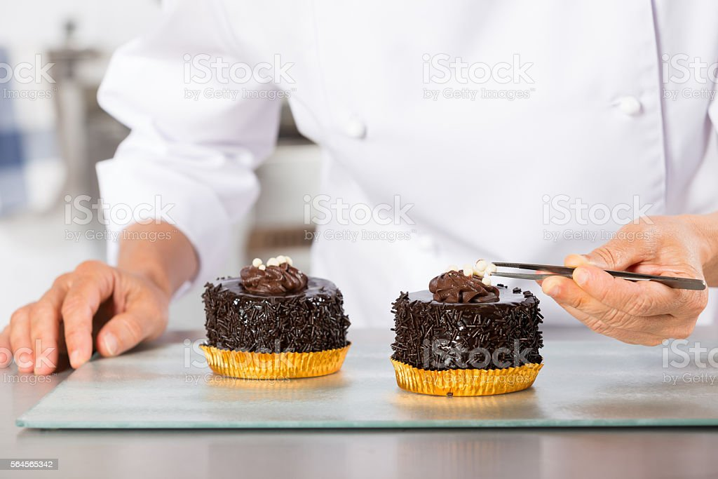 Chef finishing a cake stock photo
