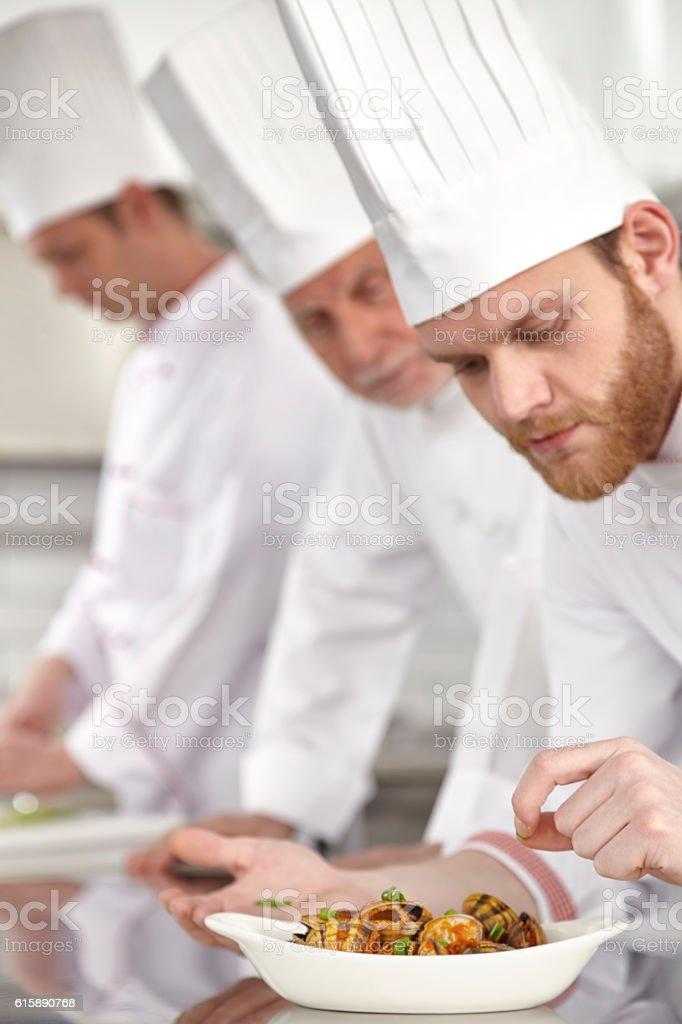 Chef finishing Oyster dish stock photo