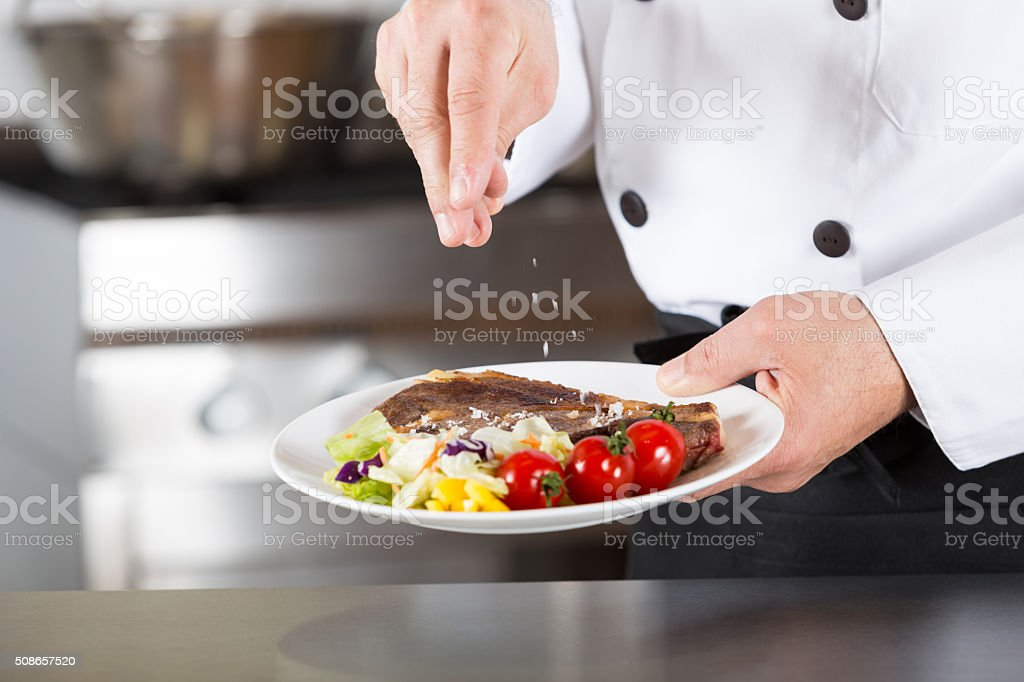 Chef finishing your plate stock photo