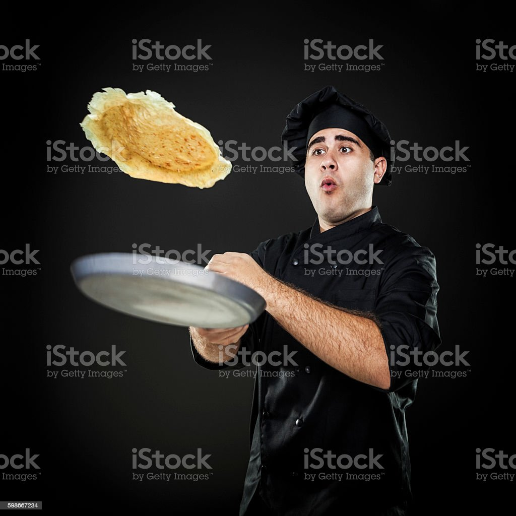 Chef flipping crepes stock photo