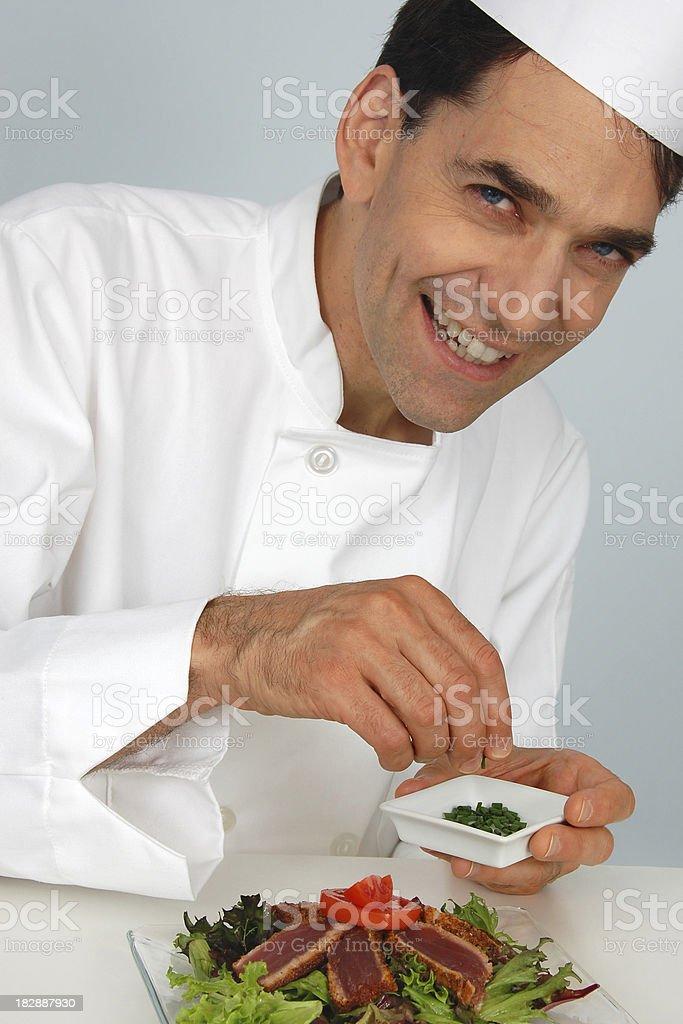 Chef Garnishing Seared Tuna Salad royalty-free stock photo