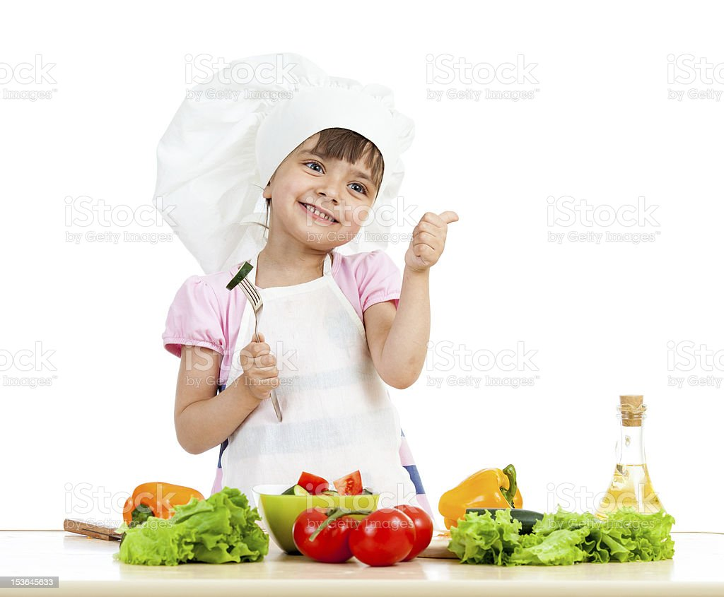Chef girl preparing healthy food over white background royalty-free stock photo
