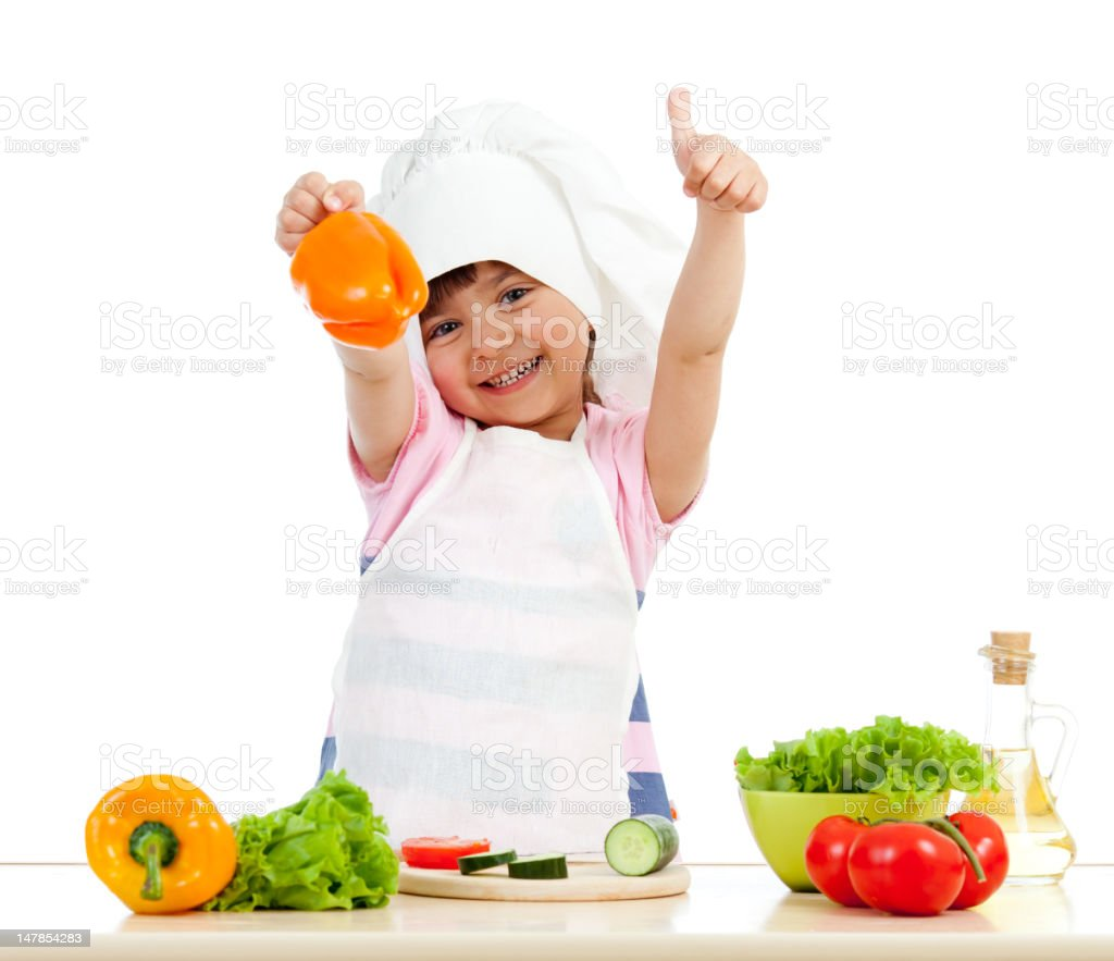 Chef girl preparing healthy food showing thumb up approving sign royalty-free stock photo
