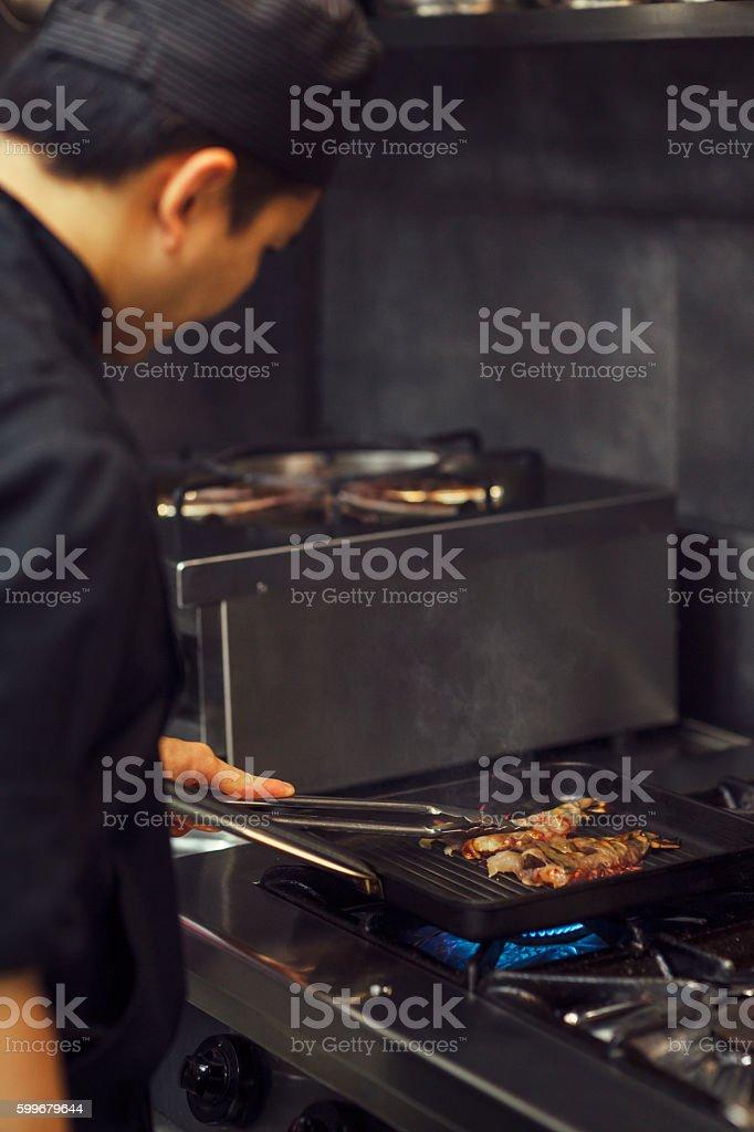 Chef Grilling King Prawn. stock photo