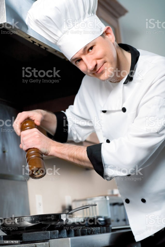 Chef Grinding Pepper royalty-free stock photo