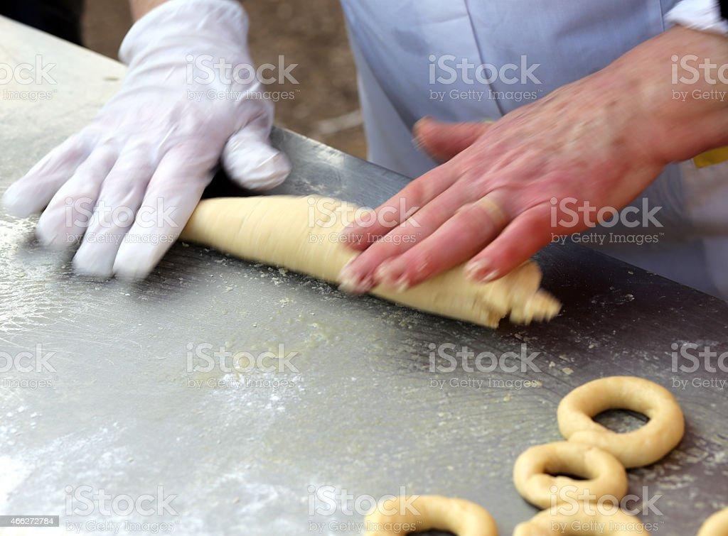 chef hand prepares homemade doughnuts stock photo