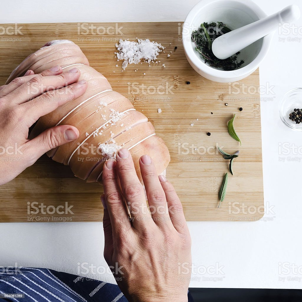 Chef hands and raw meat, preparing for roast stock photo