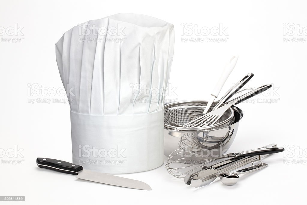 Chef Hat and utensils stock photo