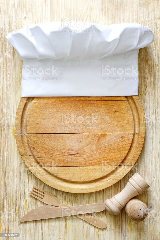 Chef hat on cutting board abstract food background stock photo