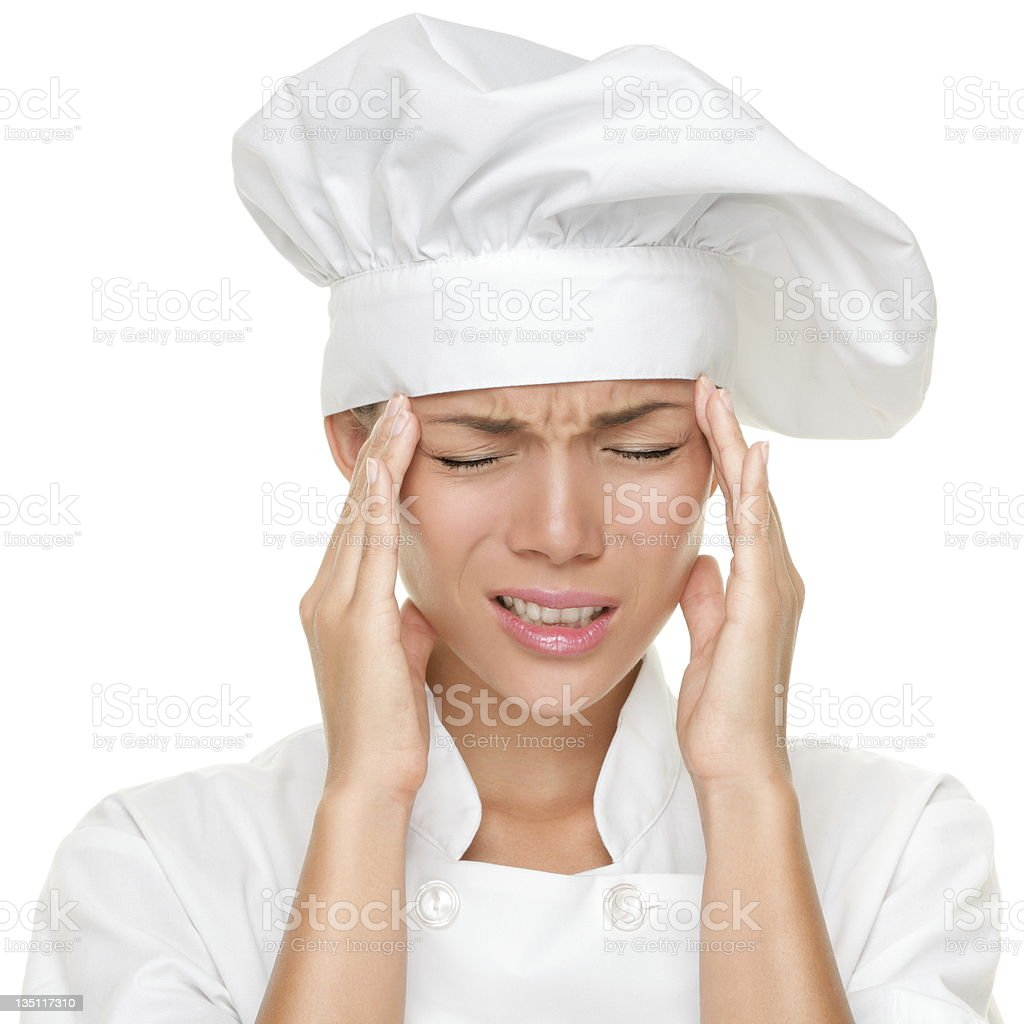 Chef headache and stress at work stock photo