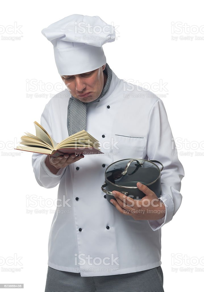 Chef holding a book and a pot stock photo