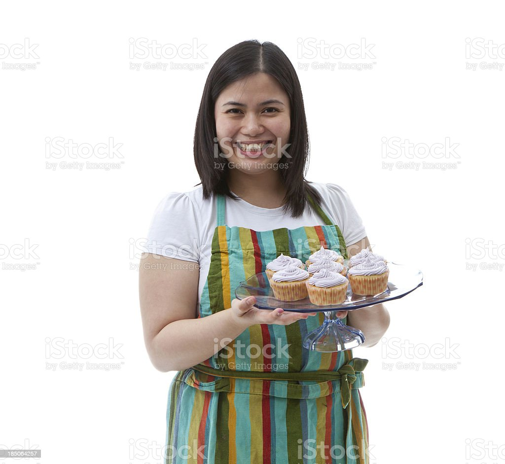 Chef holding a tray of cup-cakes royalty-free stock photo