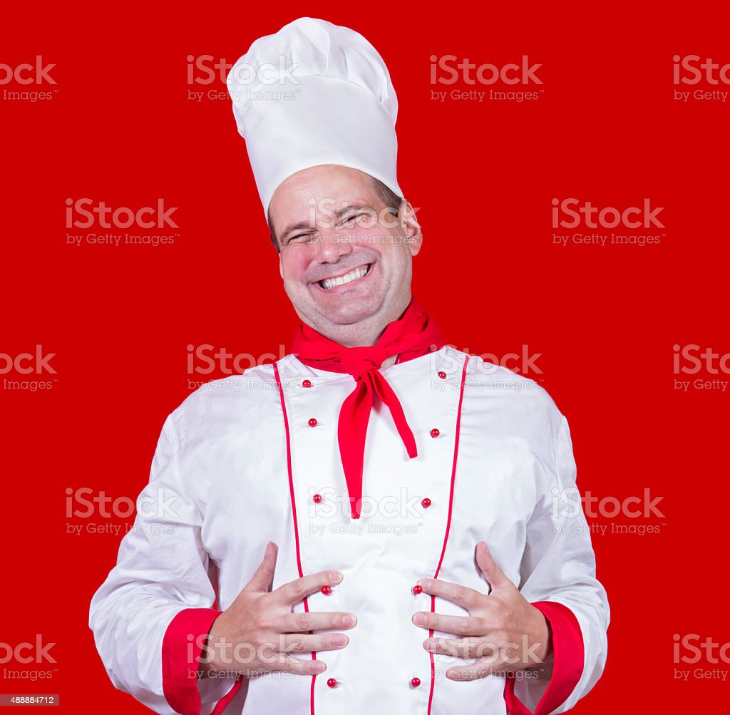 chef holding hands on his belly stock photo