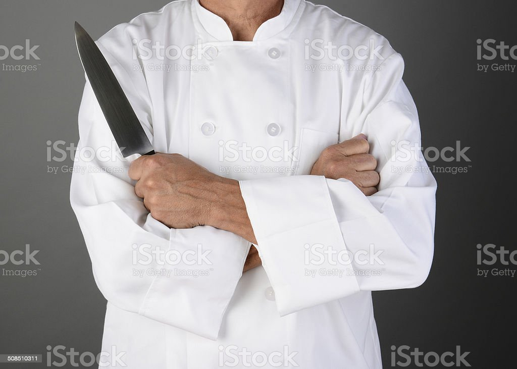Chef Holding Knife stock photo