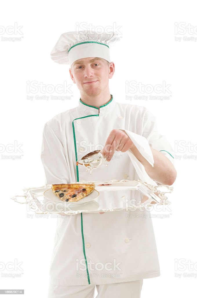 Chef holding plate with a pizza slice stock photo