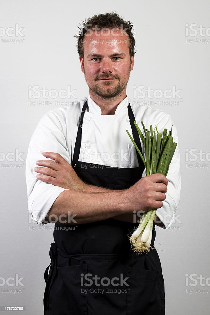 chef holding spring onions royalty-free stock photo