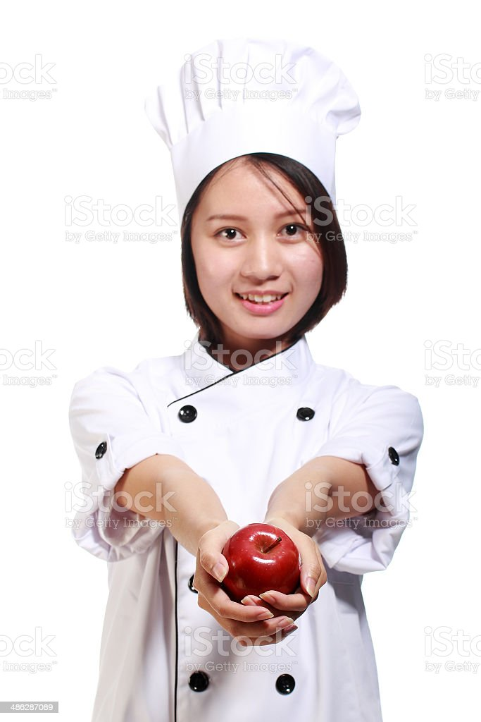 Chef holding the apple royalty-free stock photo