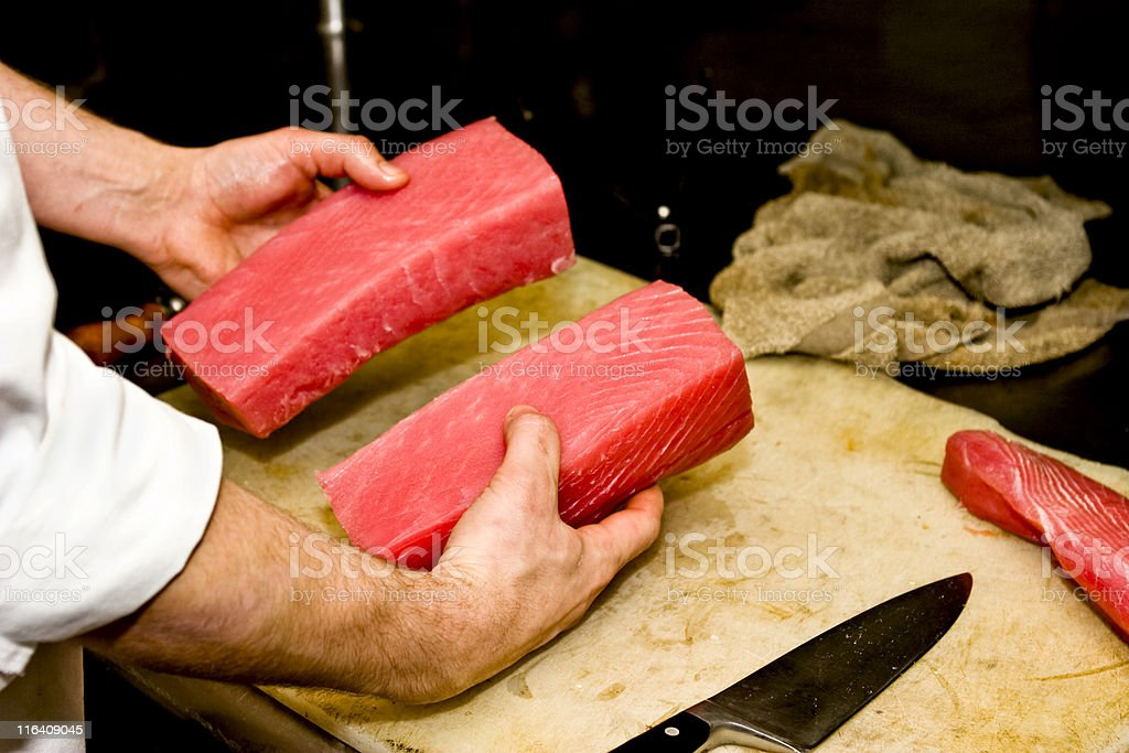 Chef holding two pieces of Ahi Tuna stock photo
