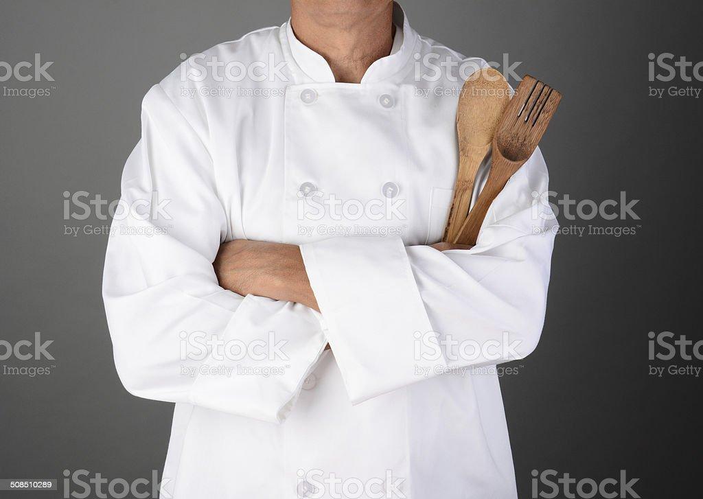 Chef Holding Wood Utensils stock photo