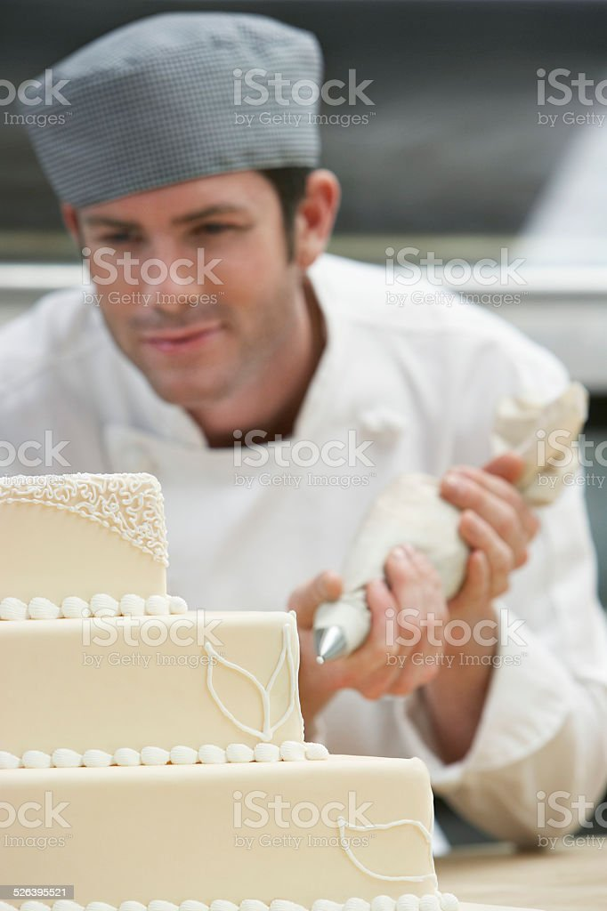 Chef Icing Wedding Cake stock photo