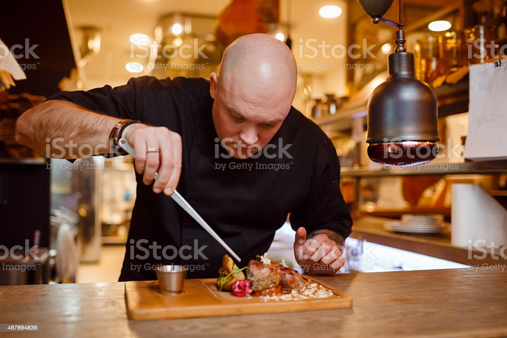 Chef in a black uniform jacket stock photo