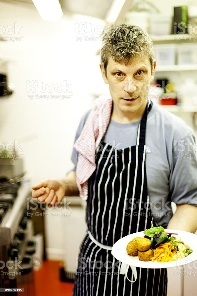 Chef in a vegetarian kitchen royalty-free stock photo
