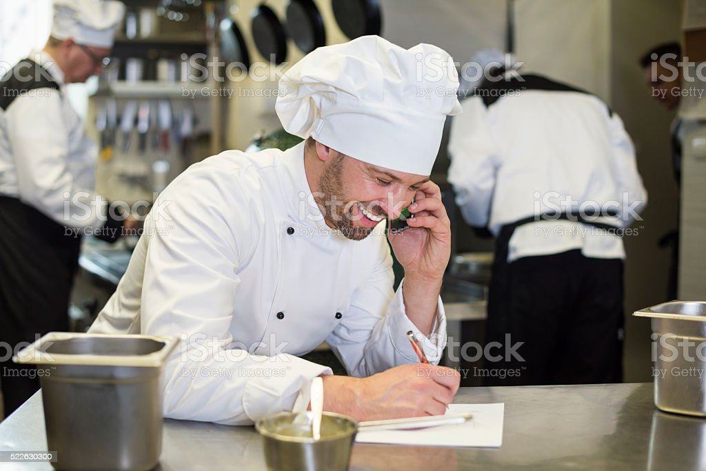 Chef in good relations with supplier stock photo
