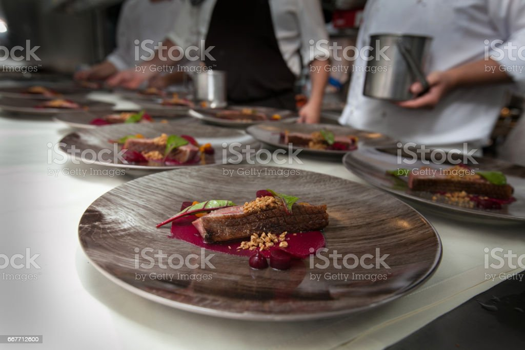 Chef in hotel or restaurant kitchen cooking for dinner stock photo